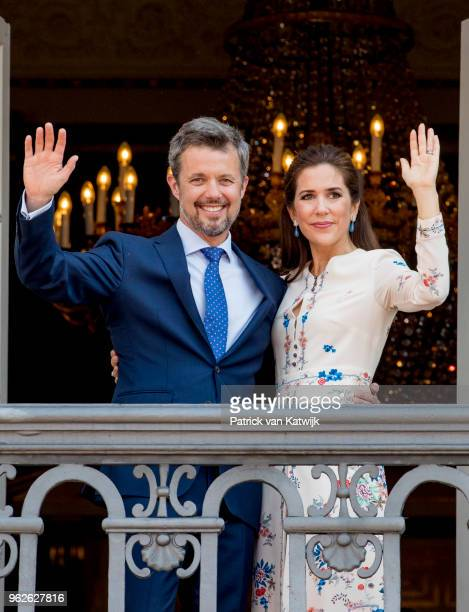 Crown Prince Frederik of Denmark and Crown Princess Mary of Denmark appear on the balcony as the Royal Life Guards carry out the changing of the...