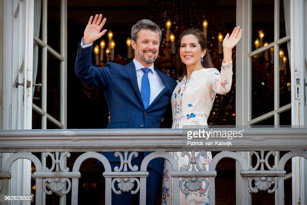 Crown Prince Frederik of Denmark and Crown Princess Mary of Denmark waves as the Royal Life Guards carry out the changing of the guard on Amalienborg...