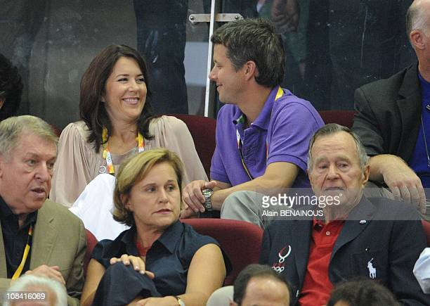 Crown Prince Frederik of Denmark and his wife Crown Princess Mary during a preliminary basketball match at the Olympic Basketball Gymnasium in...