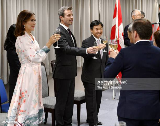 Crown Prince Frederik of Denmark Crown Princess Mary of Denmark and Japanese Crown Prince Naruhito toast glasses at a reception at the National...