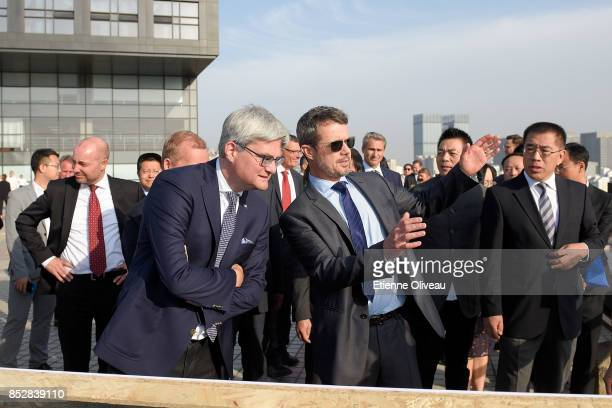 Crown Prince Frederik of Denmark discusses with Danish Minister of Higher Education, Soren Pind as they look over the city from the terrace of the...