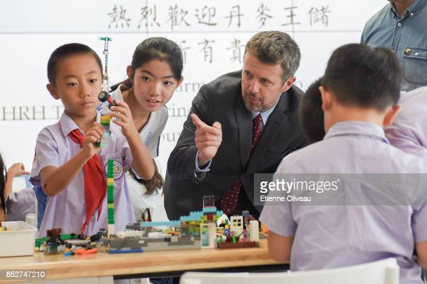 Crown Prince Frederik of Denmark discusses with kids during his visit of the Tsinghua Life Long Learning Lab, TULL dedicated to promotion research in...