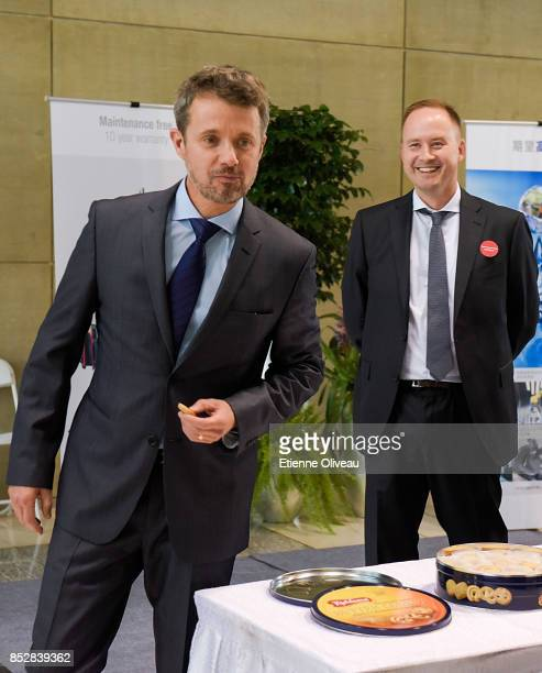Crown Prince Frederik of Denmark eats a cookie during 'Explore Danish Living', an exhibition about Copenhagen, as it will be the guest city during...