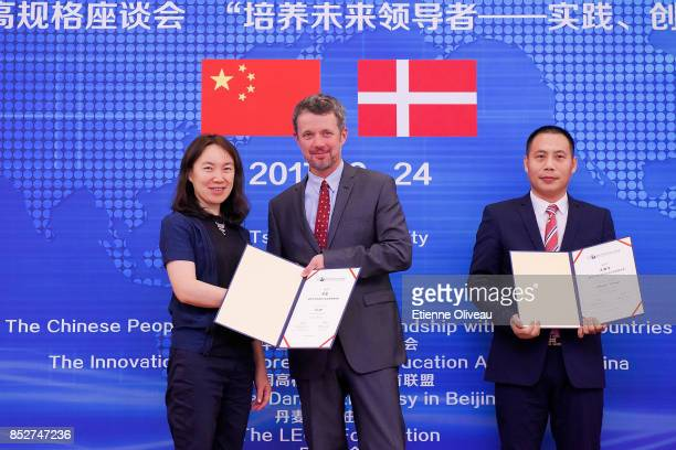 Crown Prince Frederik of Denmark hands over a certificate to a student during the Opening of the Sino-Danish high-level seminar, Educating the...