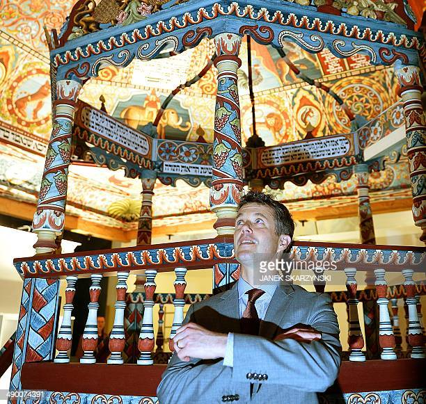 Crown Prince Frederik of Denmark looks at a reconstructed synagogue ceiling as he visits the Museum of the History of Polish Jews in Warsaw on May 13...