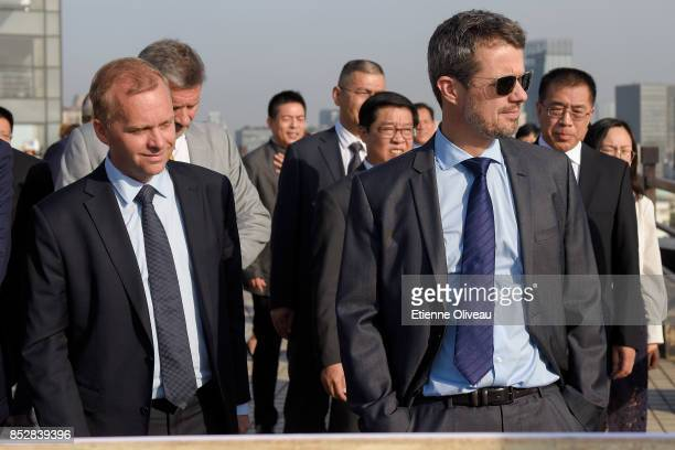 Crown Prince Frederik of Denmark looks over the city from the terrace of the Gehua Plaza after the signing ceremony between Danish and Chinese...