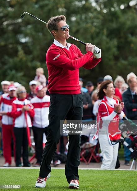 Crown Prince Frederik of Denmark makes his shot at the 1st hole prior to the ProAm at Himmerland Golf Spa Resort on August 13 2014 in Aalborg Denmark