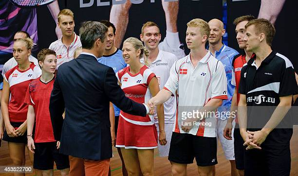 Crown Prince Frederik of Denmark meets player Kim Astrup during the Danish National Badminton Team training ahead of the Badminton World...