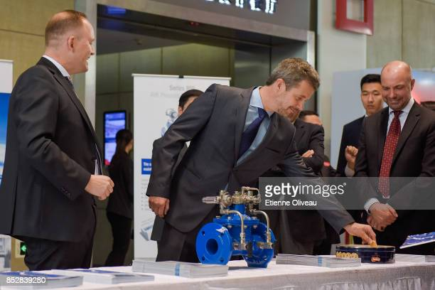 Crown Prince Frederik of Denmark picks up a cookie during 'Explore Danish Living', an exhibition about Copenhagen, as it will be the guest city...