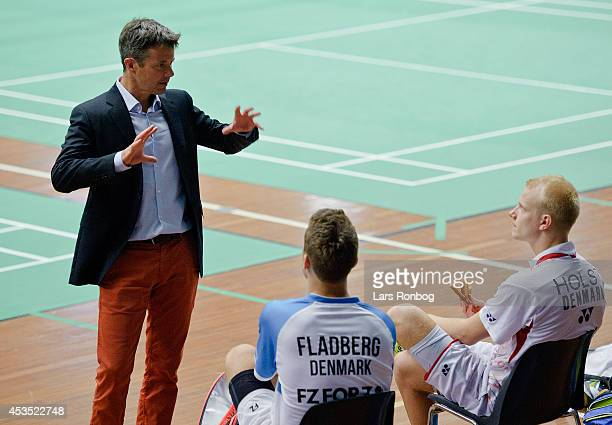 Crown Prince Frederik of Denmark speaks Rasmus Fladbeg and Emil Holst during his visit to the Danish National Badminton Team training ahead of the...