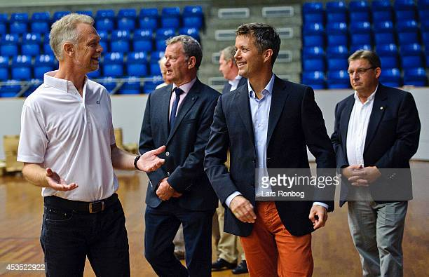 Crown Prince Frederik of Denmark speaks to Finn TrarupHansen head of sports of Badminton Danmark during his visit to the Danish National Badminton...