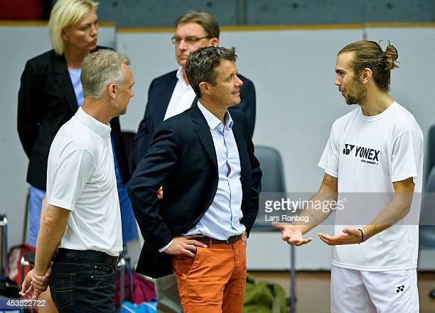 Crown Prince Frederik of Denmark speaks to player Jan O Jorgensen during the Danish National Badminton Team training ahead of the Badminton World...