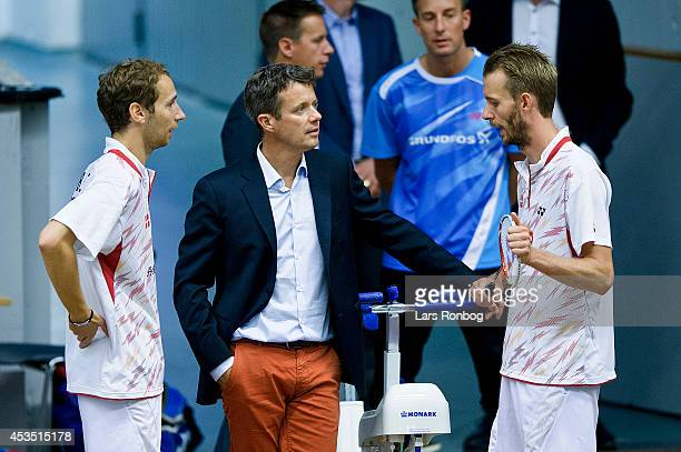 Crown Prince Frederik of Denmark speaks to players Mathias Boe and Carsten Morgensen during the Danish National Badminton Team training ahead of the...