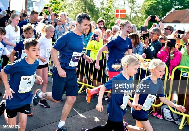 Crown Prince Frederik of Denmark takes part in the Royal Run event in Aalborg Denmark on May 21 2018 70000 Danes in the five largest cities of...