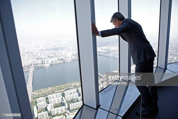 Crown Prince Frederik of Denmark walks on the glass floor and sees the view of Seoul at the observation deck on the 120th floor of Lotte World Tower,...