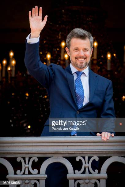Crown Prince Frederik of Denmark waves as the Royal Life Guards carry out the changing of the guard on Amalienborg Palace square on the occasion of...