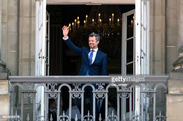 Crown Prince Frederik of Denmark waves ro rhe people on the Amalienborg Palace square on the occasion of his 50th birthday on May 26 2018 in...