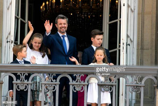 Crown Prince Frederik of Denmark with his children waves ro rhe people on the Amalienborg Palace square on the occasion of his 50th birthday on May...