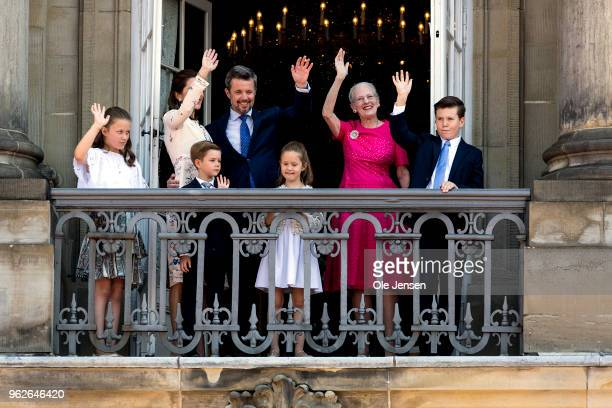 Crown Prince Frederik of Denmark with his family waves ro rhe people on the Amalienborg Palace square on the occasion of his 50th birthday on May 26,...