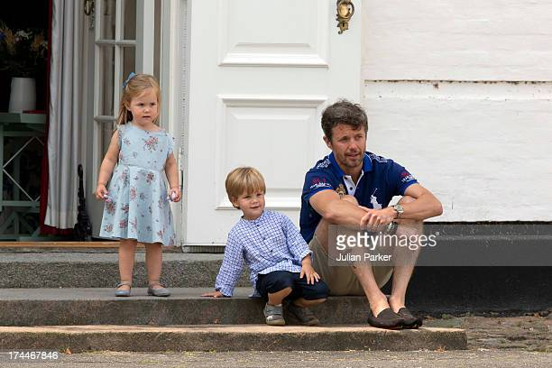 Crown Prince Frederik of Denmark with Prince Vincent and Princess Josephine watch the changing of the Guard at Grasten Castle after the annual Summer...