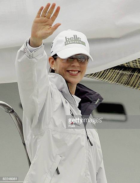 Crown Prince Frederik of Denmark's Australian wife Princess Mary waves as she departs for a yacht race against her husband on Sydney harbour on...
