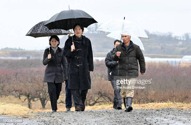 Crown Prince Fumihito, Crown Prince Akishino and Crown Princess Kiko of Akishino inspect the damage of the flood of Abukumagawa River by torrential...