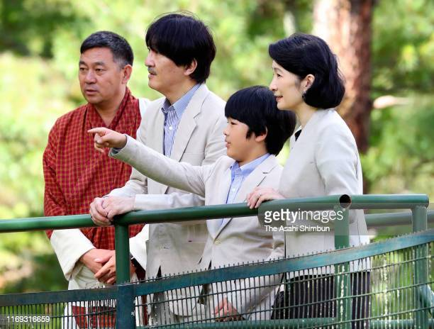 Crown Prince Fumihito or Crown Prince Akishino Crown Princess Kiko of Akishino and Prince Hisahito watch takins on August 20 2019 in Thimphu Bhutan