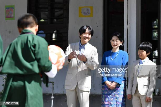 Crown Prince Fumihito, or Crown Prince Akishino, Crown Princess Kiko of Akishino and Prince Hisahito visit a school on August 20, 2019 in Thimphu,...