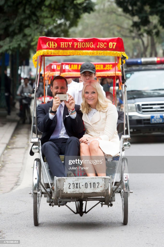 Crown Prince Haakon and Crown Princess Mette-Marit of Norway during day 1 of an official visit to Vietnam, take a Cyclo ride back to the Sofitel Metropole Hotel on March 19, 2014 in Hanoi, Vietnam.