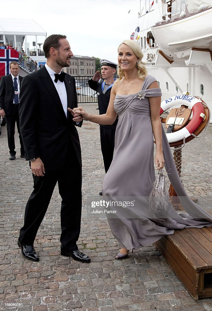 Crown Prince Haakon And Crown Princess Mette-Marit Of Norway Leave The Royal Yacht Ks Norge To Attend A Party At Drottningholm Palace Near Stockholm As Part Of The Pre Wedding Celebrations For Crown Princess Victoria Of Sweden And Daniel Westling.