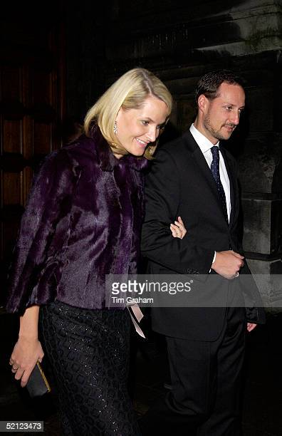 Crown Prince Haakon and Princess MetteMarit of Norway walk arm in arm at the V A for a reception to launch the exhibition 'Style and Splendour Queen...
