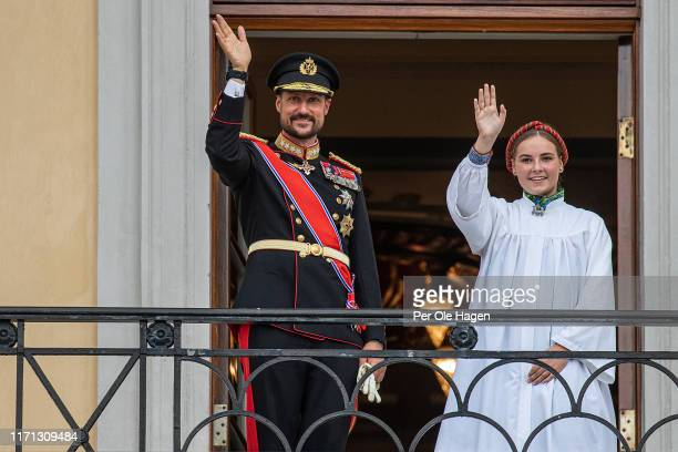 Crown Prince Haakon of Norway and daughter Princess Ingrid Alexandra of Norway wave to crowds as they attend her confirmation service n the Palace...