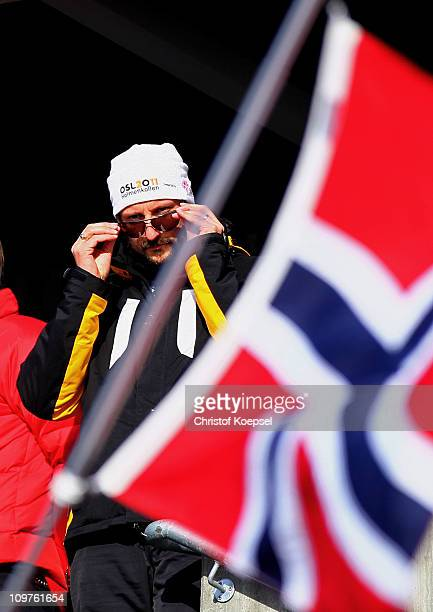 Crown Prince Haakon of Norway attend the Men's Cross Country 4x10km Relay race during the FIS Nordic World Ski Championships at Holmenkollen on March...
