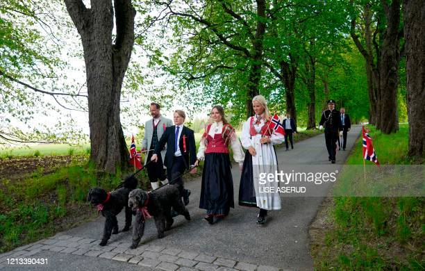 Crown Prince Haakon of Norway Crown Princess MetteMarit of Norway Princess Ingrid Alexandra and Prince Sverre Magnus walk dogs during the May 17th...