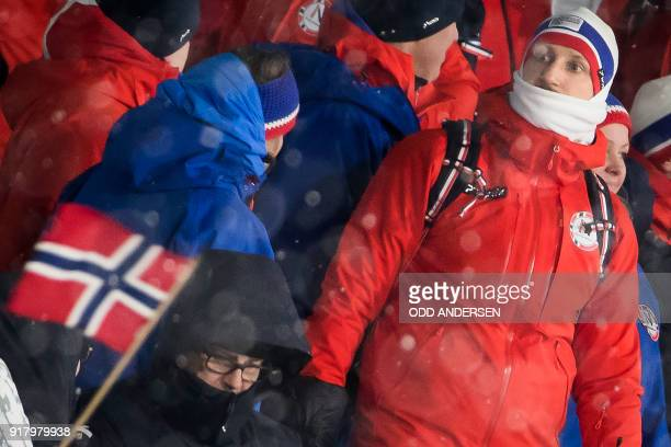 Crown Prince Haakon of Norway is wrapped up warm in the stand as he follow Norway's Johannes Hoesflot Klaebo racing to win the men's crosscountry...