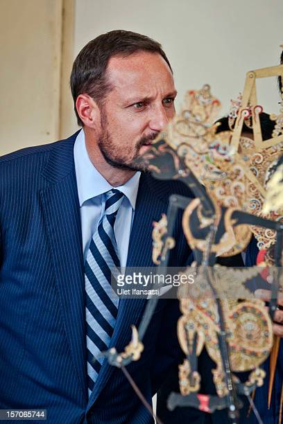 Crown Prince Haakon of Norway listens to Sri Sultan Hamengkubuwono X as he talks about the traditional Javanese puppet or Wayang during visit...