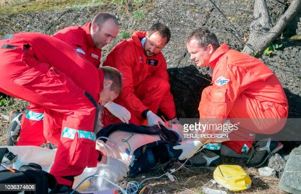 Crown Prince Haakon of Norway particpates in a rescue exercise held by The Norwegian Airborne Rescue Team with Lukas Olsen Thomas N Dahle Haakon and...