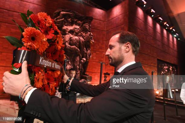 Crown Prince Haakon of Norway positions a wreath at the 5th World Holocaust Forum at Yad Vashem Holocaust memorial museum on January 23 2020 in...
