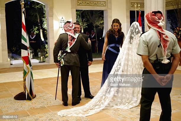 Crown Prince Hamzeh of Jordan and his bride Princess Noor greet Jordan's King Abdullah II and his wife Queen Rania during their wedding on May 27...
