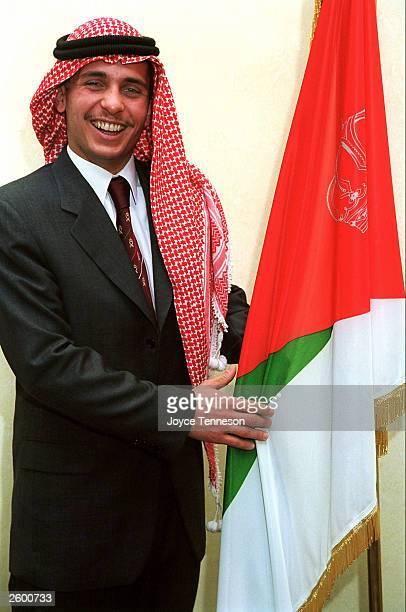 Crown Prince Hamzeh poses with flag on February 10 2000 in Ahman Jordan