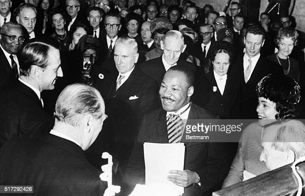 Crown Prince Harald and King Olav of Norway congratulate American civil rights activist Martin Luther King Jr after he receives the Nobel Peace Prize...