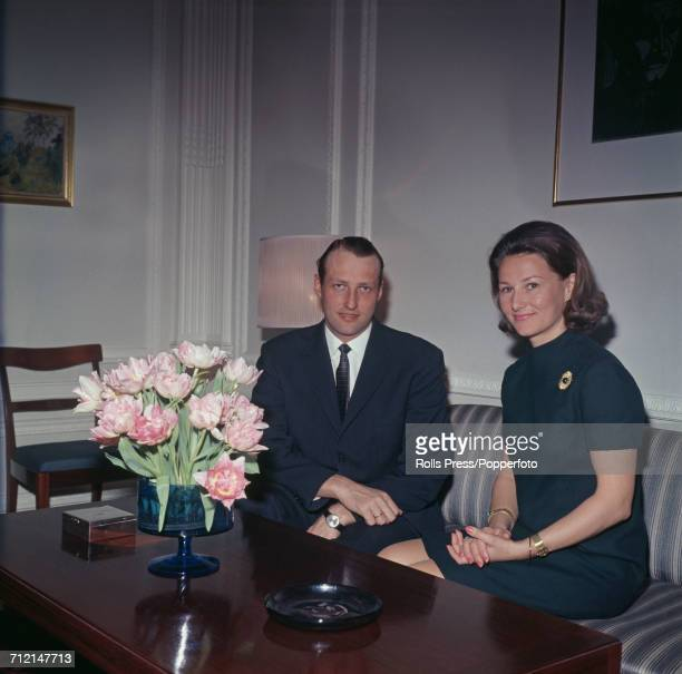 Crown Prince Harald of Norway pictured with his wife Sonja Haraldsen at a reception in London in March 1969.
