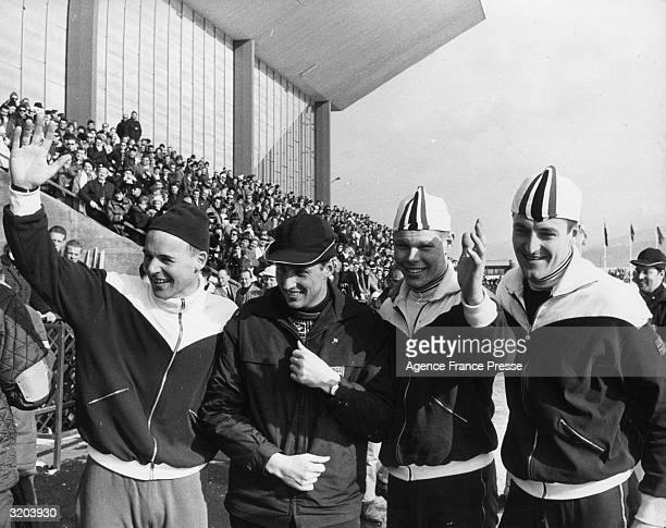 Crown Prince Harald of Norway poses with Norwegian skaters Knut Johannesen Per Ivar Moe and Fred Anton Maier who won the gold silver and bronze...