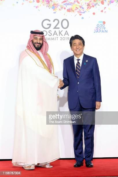 Crown Prince Mohammed bin Salman of Saudi Arabia is welcomed by Japanese Prime Minister Shinzo Abe on the first day of the G20 summit on June 28 2019...