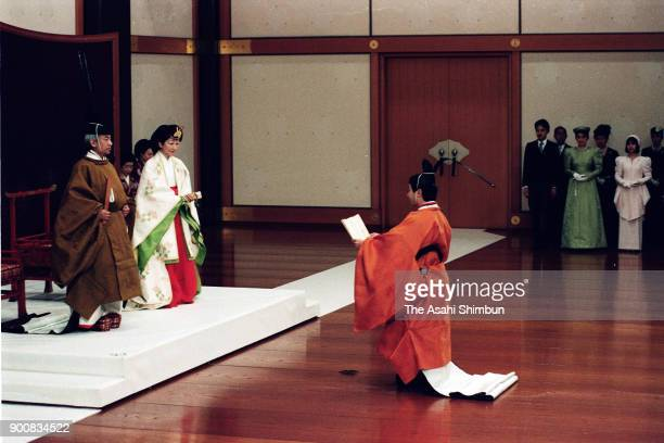 Crown Prince Naruhito addresses in front of Emperor Akihito and Empress Michiko during the Ceremonial Investiture at the Imperial Palace on February...