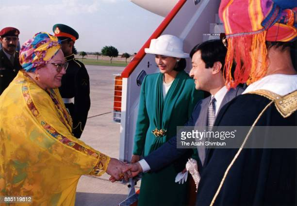 Crown Prince Naruhito adn Crown Princess Masako are seen on arrival at the Muscat International Airport on November 9 1994 in Muscat Oman