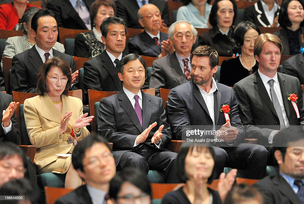 Crown Prince Naruhito (2L) and actor Hugh Jackman (2R) applaud during the 'Les Miserables' charity premiere on December 18, 2012 in Tokyo, Japan.
