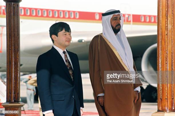 Crown Prince Naruhito and Crown Prince Khalifa bin Zayed Al Nahyan of the UAE attend the welcome ceremony on arrival at Abu Dhabi Airport on January...