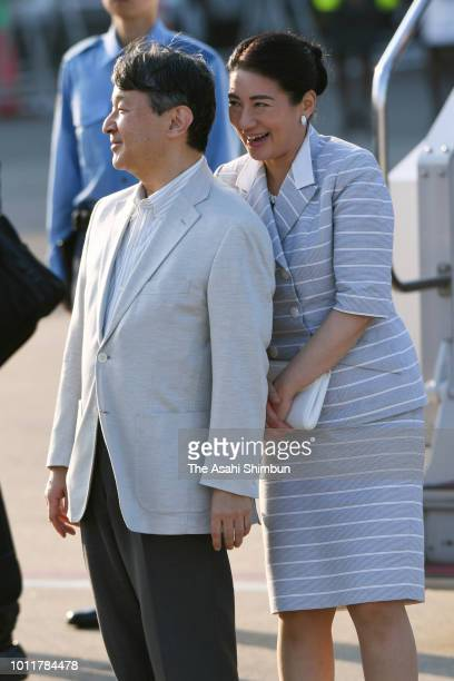 Crown Prince Naruhito and Crown Princess Masako are seen on arrival at the Hanshin Koshien Stadium to attend the opening ceremony of the 100th...