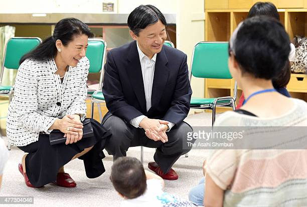 Crown Prince Naruhito and Crown Princess Masako inspect a childraising support center 'Yuttarino' on June 16 2015 in Tokyo Japan